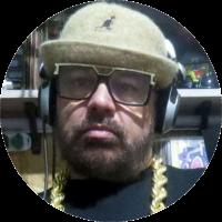 Presidente da Confederação Paulista de Breaking - CBRB, Vice-Preseidente da Federação Paulista de Breaking – FSPB, iniciou sua carreira como DJ e produtor em 1987. Atualmente é DJ residente do Encontro São Bento, produtor do DMC Brasil e da Batalha Final; colaborador da pesquisa Pedagogia Hip-Hop.